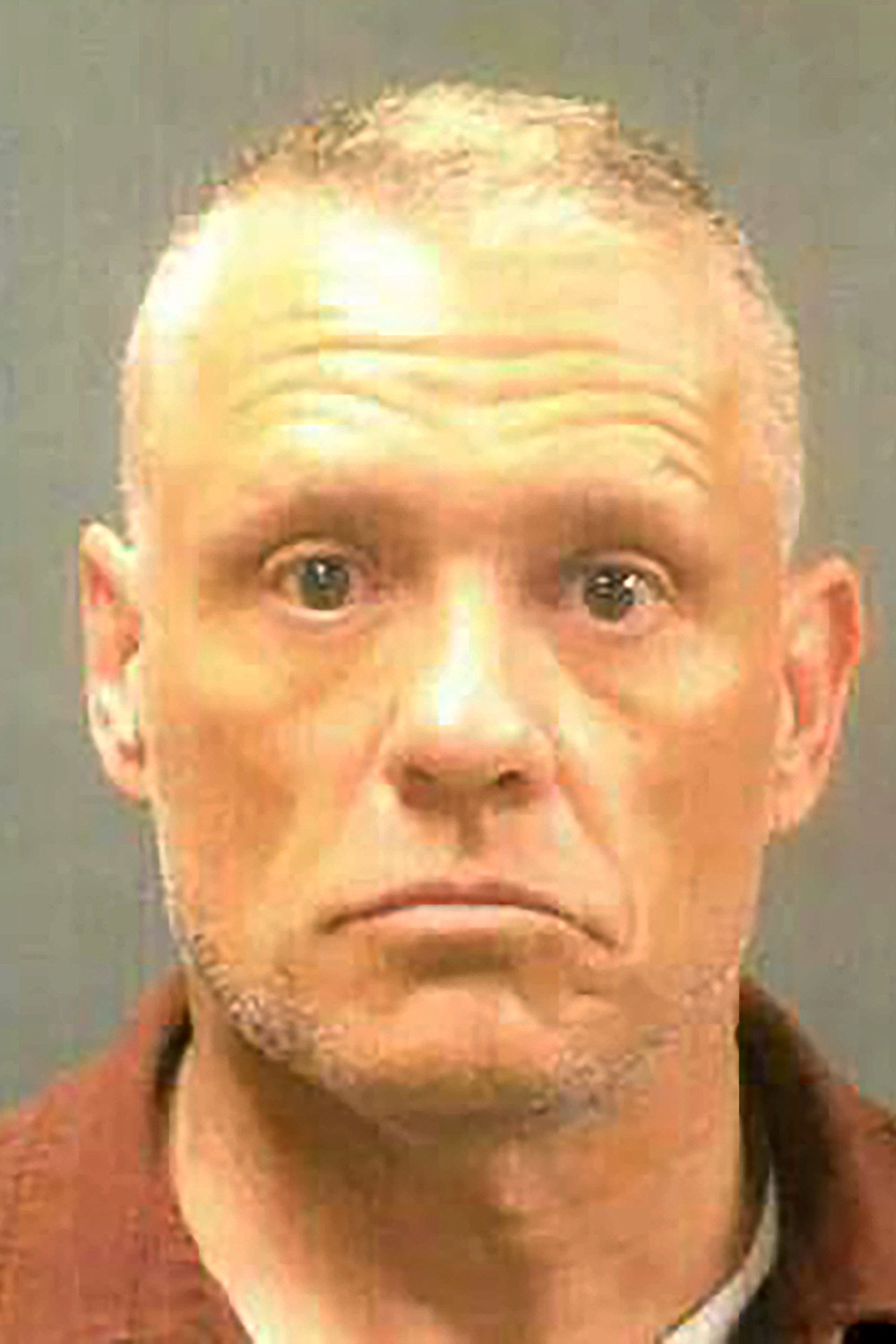 This undated handout booking photo provided by the New Hampshire Attorney General's office shows Jeffrey Buskey, one of six men arrested Wednesday, April 7, 2021, in connection with sexual abuse allegations at New Hampshire's state-run youth detention center, the attorney general's office said. (New Hampshire Attorney General's Office via AP)