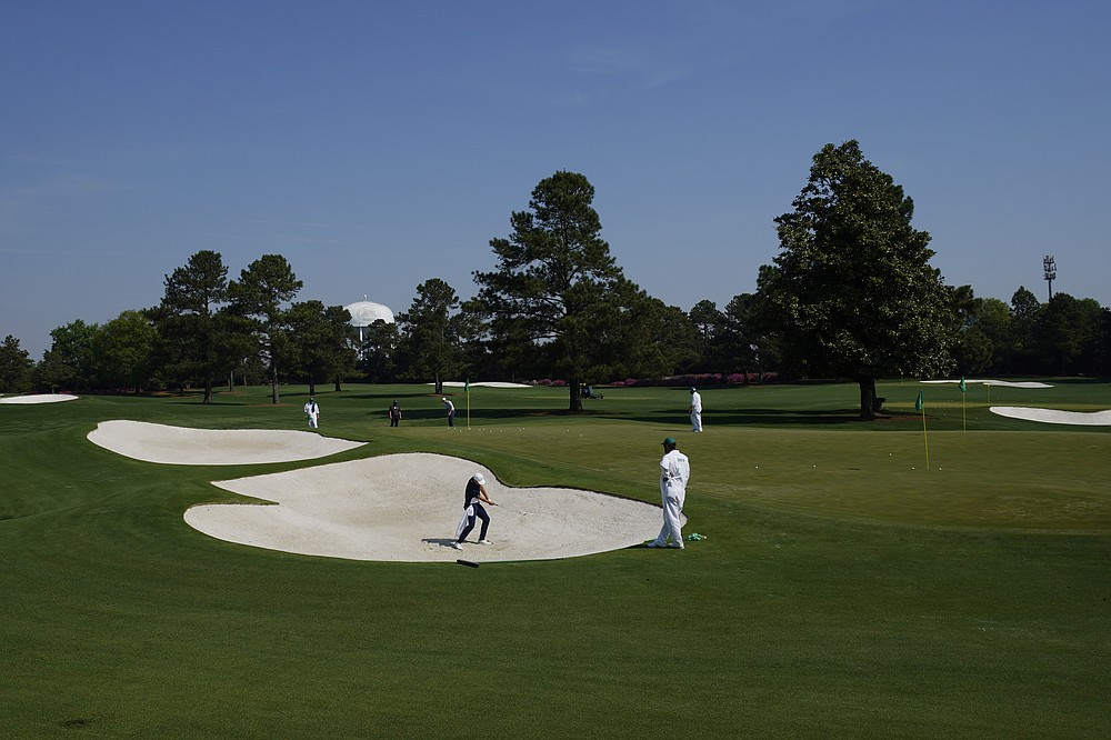 Jordan Spieth hits out of a bunker on the driving range during a practice round for the Masters golf tournament on Wednesday, April 7, 2021, in Augusta, Ga. (AP Photo/Charlie Riedel)