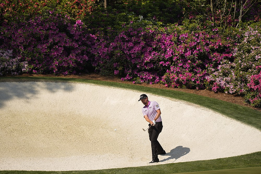 Webb Simpson hits out of a bunker at the 13th hole during a practice round for the Masters golf tournament on Wednesday, April 7, 2021, in Augusta, Ga. (AP Photo/David J. Phillip)