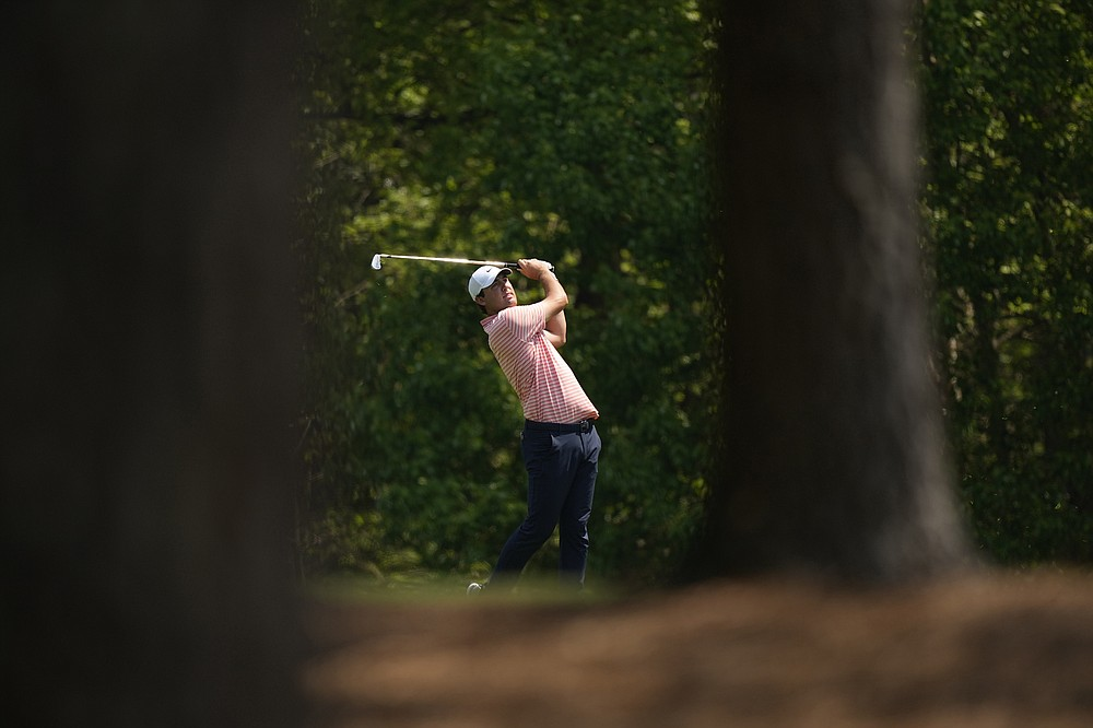 Scottie Scheffler hits on the 11th fairway during a practice round for the Masters golf tournament on Wednesday, April 7, 2021, in Augusta, Ga. (AP Photo/David J. Phillip)