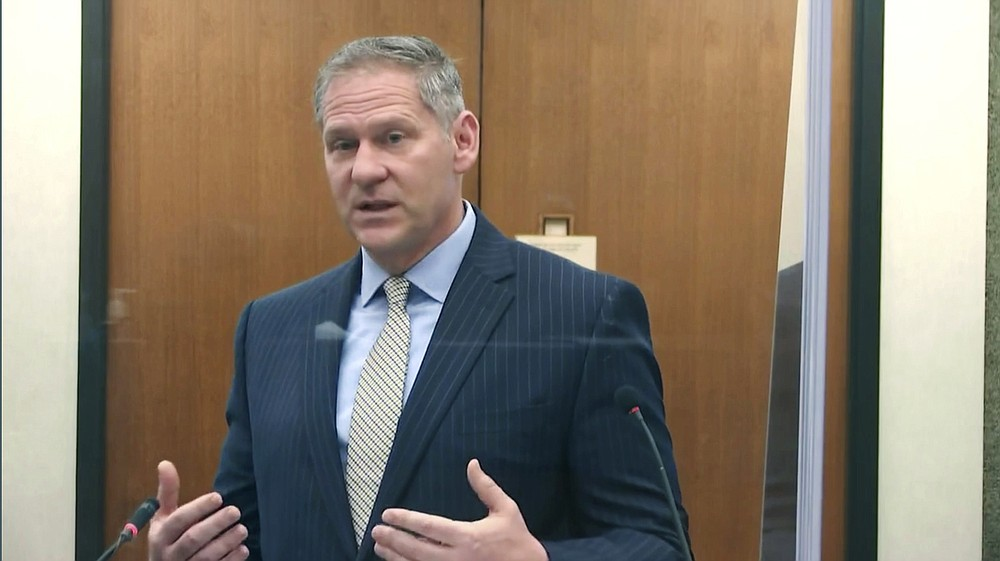 In this image from video, prosecutor Steve Schleicher questions witness Los Angeles police department Sgt. Jody Stiger, as Hennepin County Judge Peter Cahill presides Wednesday, April 7, 2021, in the trial of former Minneapolis police Officer Derek Chauvin at the Hennepin County Courthouse in Minneapolis. Chauvin is charged in the May 25, 2020 death of George Floyd. (Court TV via AP, Pool)