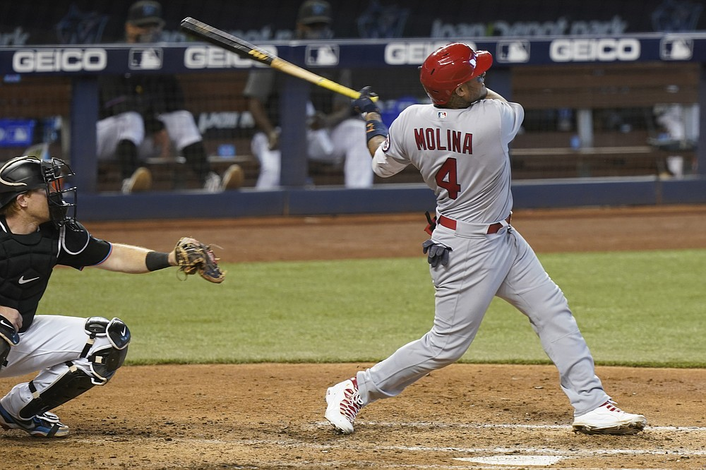 St. Louis Cardinals' Yadier Molina (4) hits a home run in the seventh inning of a baseball game against the Miami Marlins, Wednesday, April 7, 2021, in Miami. (AP Photo/Marta Lavandier)