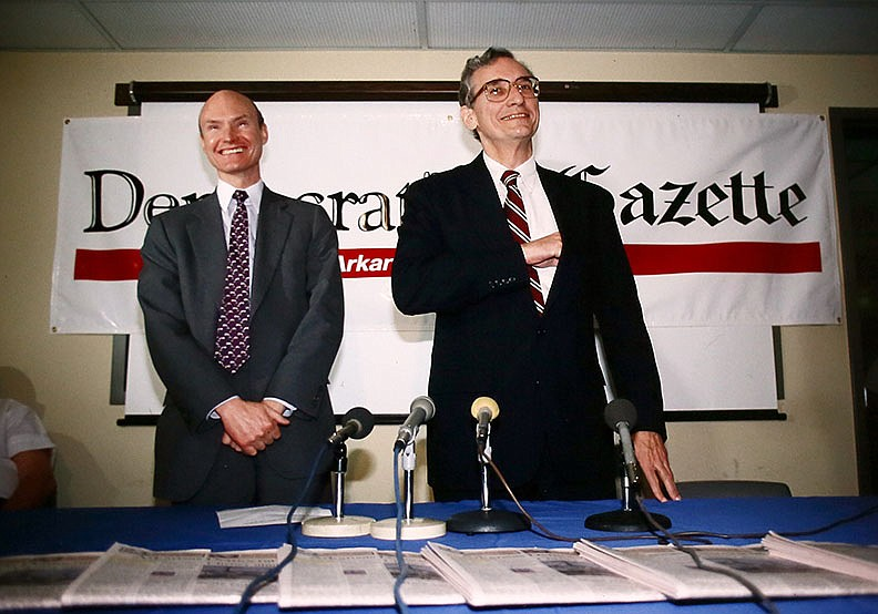 Walter E. Hussman Jr. introduces Paul Greenberg as the Arkansas Democrat Gazette's editorial page editor on March 27, 1992. Hussman, publisher of the Democrat-Gazette and chairman of WEHCO Media, Inc., said Wednesday that Greenberg's death will reverberate beyond Arkansas' borders. (Democrat-Gazette file photo)