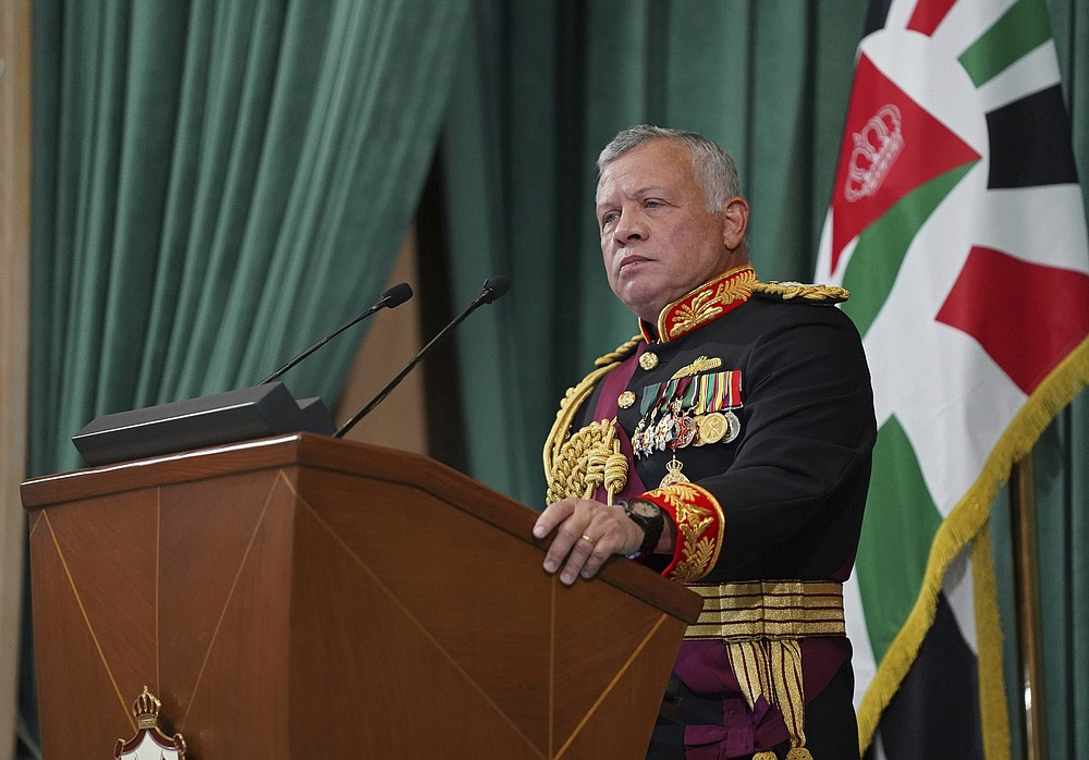 "FILE - In this Dec. 10, 2020 file photo released by the Royal Hashemite Court, Jordan's King Abdullah II gives a speech during the inauguration of the 19th Parliament's non-ordinary session, in Amman Jordan. Jordan's king addressed the public feud with his half-brother, Prince Hamzah, portraying it as an attempted ""sedition"" that caused him shock, anger and pain. The statement on Wednesday, April 7, 2021, carried by Jordan TV, marked the first time King Abdullah II addressed the unprecedented rift in the royal family which erupted over the weekend. (Yousef Allan/The Royal Hashemite Court via AP, File)"