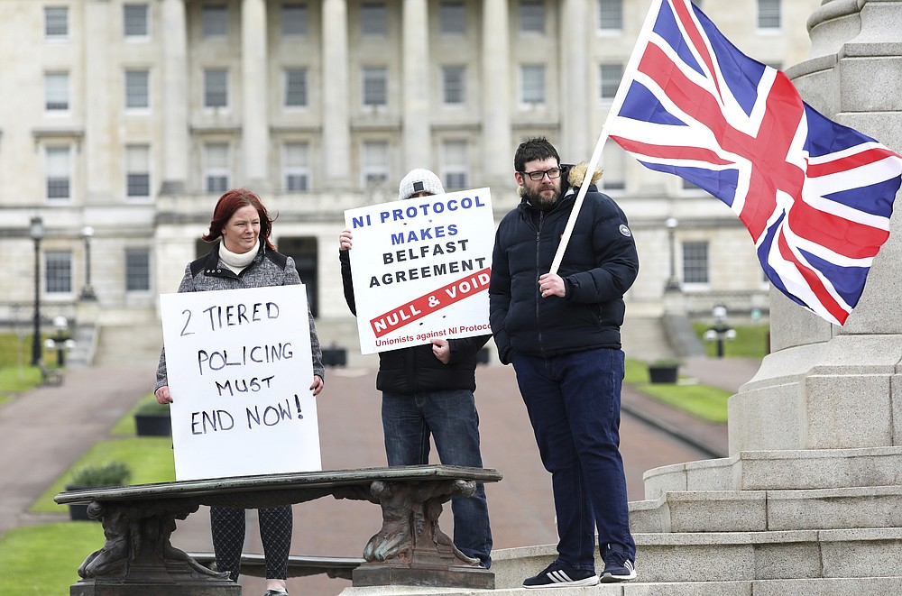 Loyalist protesters opposed to the Northern Ireland Protocol on Brexit makes his political point during a protest outside parliament buildings, Stormont, Belfast, Northern Ireland, Thursday, April 8, 2021 .(AP Photo/Peter Morrison)