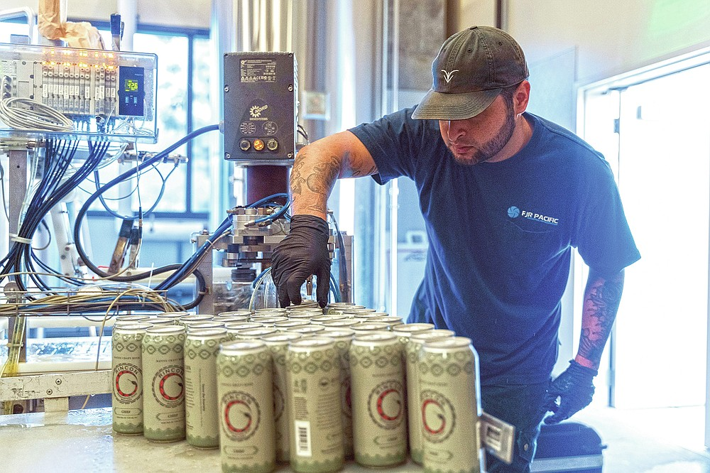 A worker from Mobile West Canning cans Luiseño Hazy IPA on June 30, 2020, at the Rincon Reservation Road Brewery in Valley Center, Calif. As Southern California's first craft brewery on tribal lands, the 3R Brewery, as it's known, aims to educate beer lovers about the Rincon Band of Luiseño Indians and inspire young tribal members with a passion for hops. (Harrah's Resort Southern California/Indian Country Today via AP)