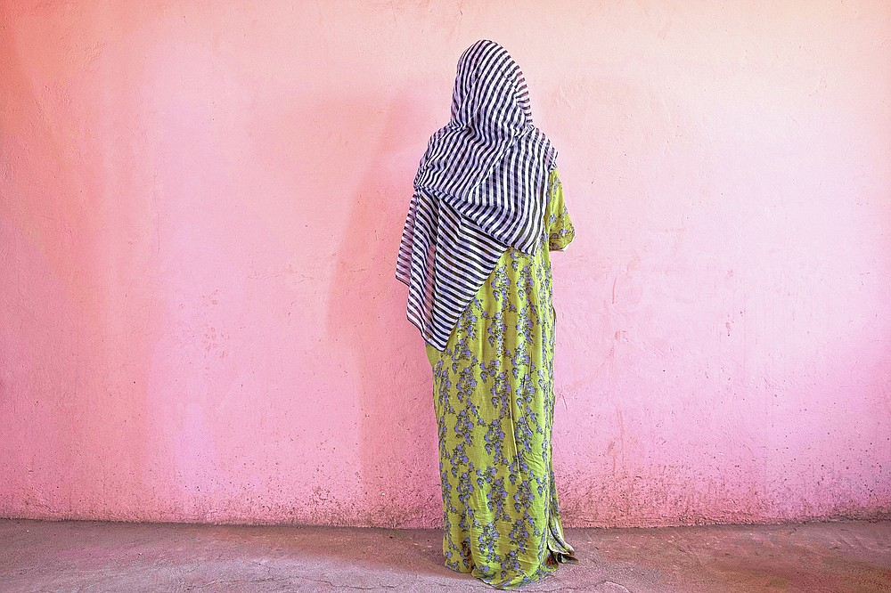 """A Tigrayan woman who says she was gang raped by Amhara fighters, stands for a portrait in eastern Sudan, near the border with Ethiopia, on March 23, 2021. """"Let the Tigray government come and help you,"""" she recalled them saying, even while they were raping her. (AP Photo/Nariman El-Mofty)"""