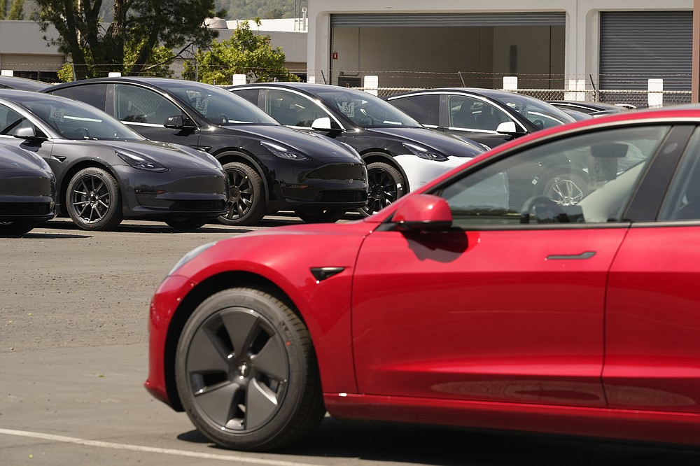 New electric cars are parked at a Tesla delivery location and service center Friday, April 2, 2021, in Corte Madera, Calif. The president and auto industry maintain the nation is on the cusp of a gigantic shift to electric vehicles and away from liquid-fueled cars, but biofuels producers and some of their supporters in Congress aren't buying it and argue now is the time to increase sales of ethanol and biodiesel, not abandon them. (AP Photo/Eric Risberg)