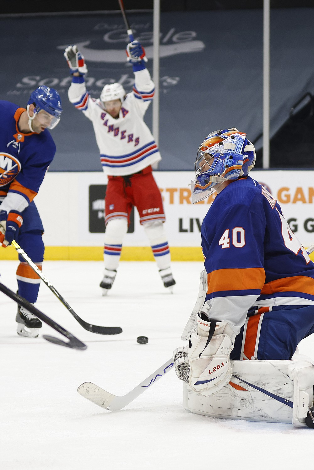 New York Islanders goalie Semyon Varlamov (40), of Russia, reacts after giving up a goal to the New York Rangers during the third period of an NHL hockey game Friday, April 9, 2021, in Uniondale, N.Y. (AP Photo/Jason DeCrow)