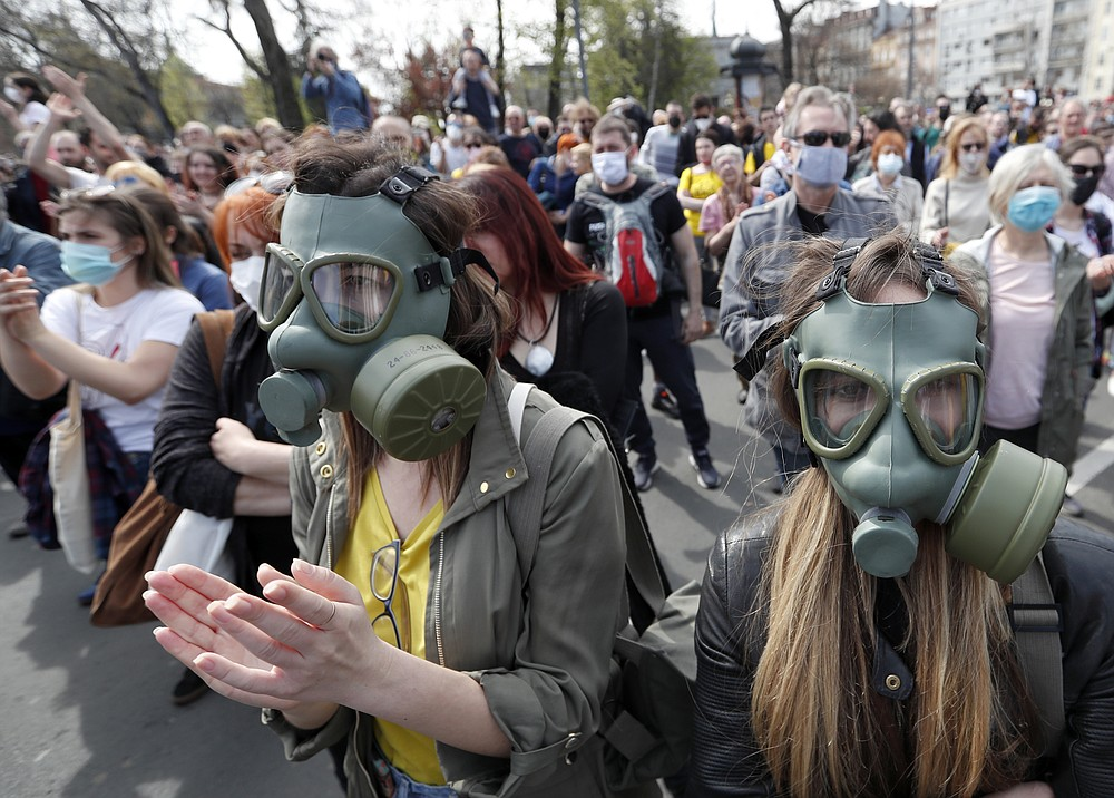 People attend a protest in front of the Serbian Parliament building in Belgrade, Serbia, Saturday, April 10, 2021. Environmental activists are protesting against worsening environmental situation in Serbia. (AP Photo/Darko Vojinovic)