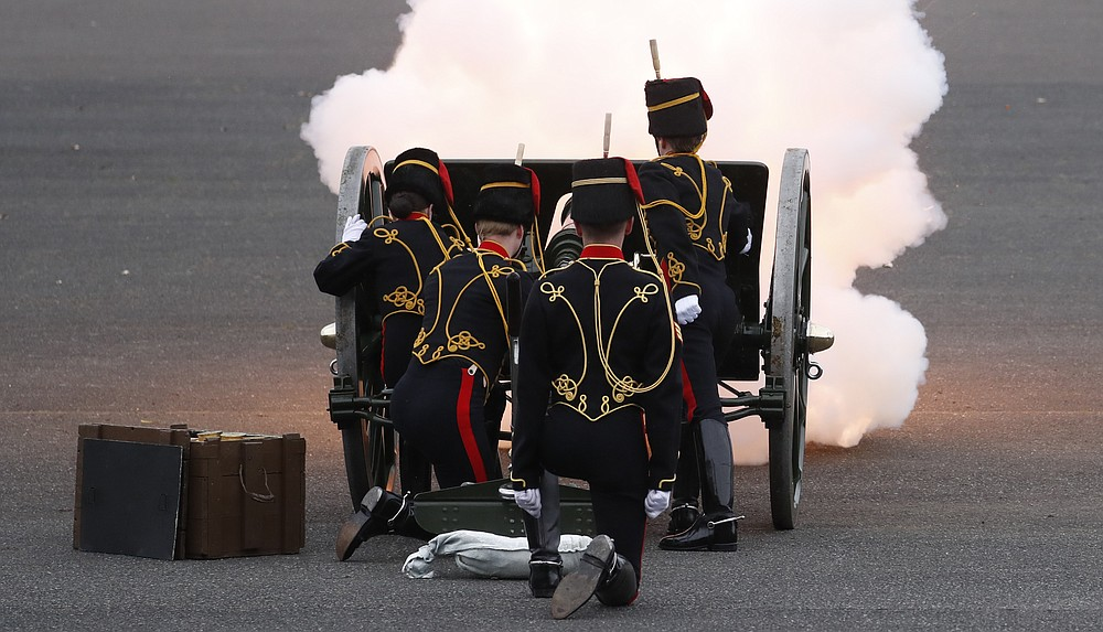 Soldiers of the Royal Horse Artillery fire a ceremonial gun during the 41 Death Gun salute in memory of Prince Philip at the Royal Artillery barracks in Woolwich, London, Saturday, April 10, 2021. Buckingham Palace officials announced Friday that Prince Philip, the husband of Queen Elizabeth II, has died . He was 99. (AP Photo/Alastair Grant, Pool)