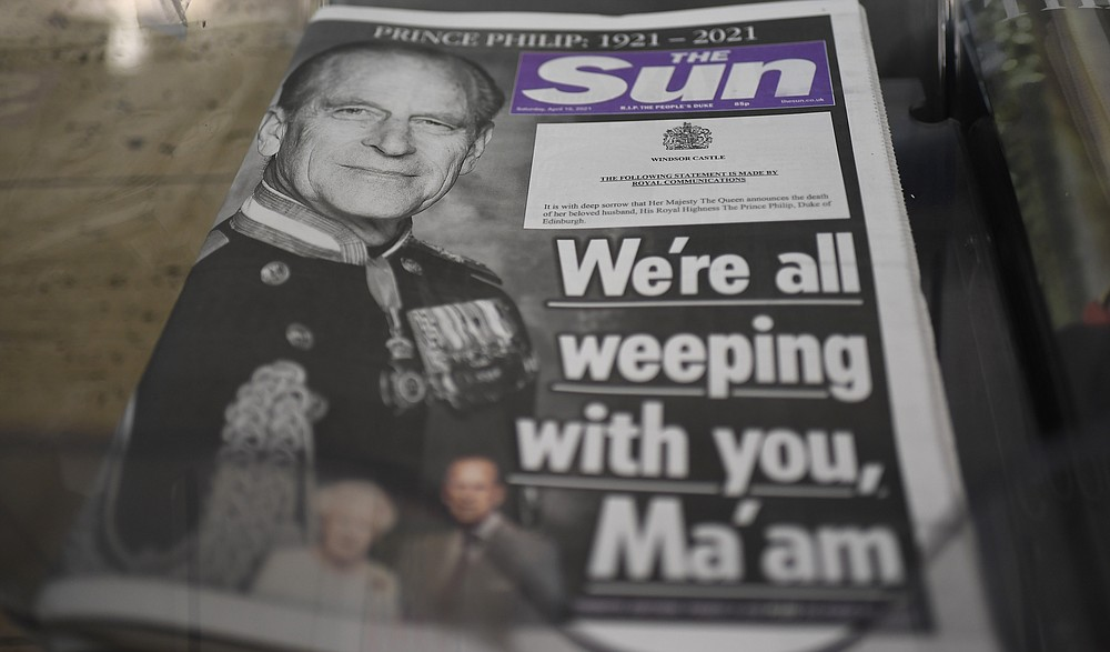 A newspaper with a front page photo of Britain's Prince Philip at a newsstand in London, Saturday, April 10, 2021. Britain's Prince Philip, the irascible and tough-minded husband of Queen Elizabeth II who spent more than seven decades supporting his wife in a role that mostly defined his life, died on Friday. (AP Photo/Alberto Pezzali)