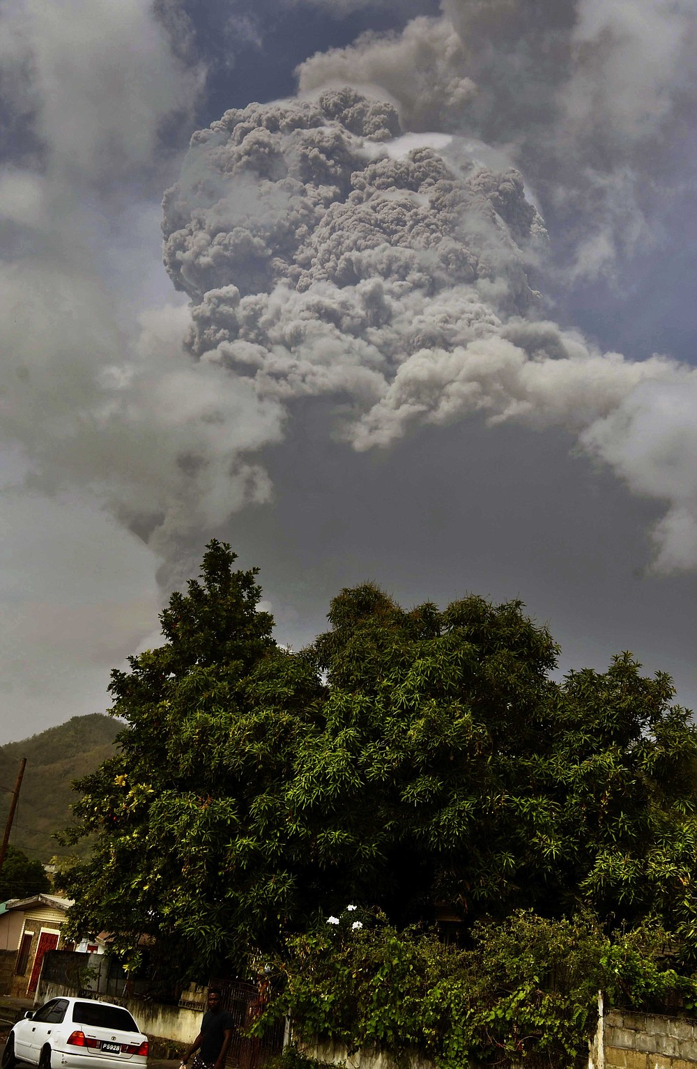 Plumes of ash rise from the La Soufriere volcano as it erupts on the eastern Caribbean island of St. Vincent, as seen from Chateaubelair, Friday, April 9, 2021. (AP Photo/Orvil Samuel)