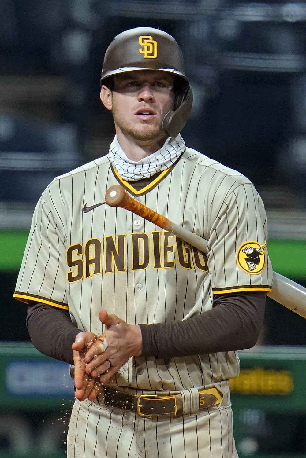 San Diego Padres' Wil Myers rubs dirt on his hands between pitches during an at-bat in the seventh inning against Pittsburgh Pirates starting pitcher Luis Oviedo during a baseball game in Pittsburgh, Monday, April 12, 2021. Myers singled off Oviedo, driving in two runs. (AP Photo/Gene J. Puskar)
