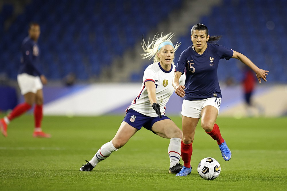 France's Eugenie Le Sommer controls the ball as United States' Julie Ertz (8) defends during an international friendly women's soccer match between the United States and France in Le Havre, France, Tuesday, April 13, 2021. (AP Photo/David Vincent)