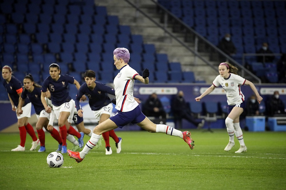 United States' Megan Rapinoe scores on a penalty kick during the first half of an international friendly women's soccer match between the United States and France in Le Havre, France, Tuesday, April 13, 2021. (AP Photo/David Vincent)