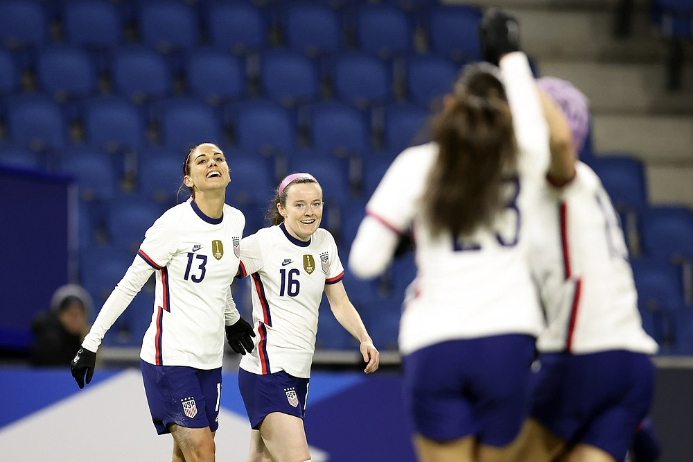 United States' Alex Morgan (13) and Rose Lavelle (16) celebrate after Morgan scored a goal against France during an international friendly women's soccer match between the United States and France in Le Havre, France, Tuesday, April 13, 2021. (AP Photo/David Vincent)