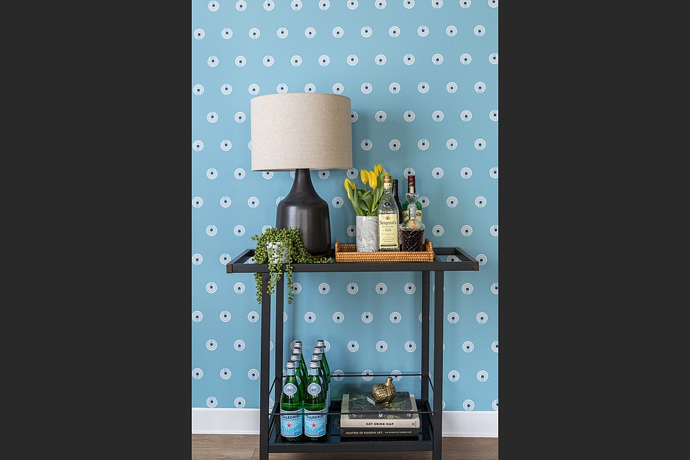 Dot Comb Blue peel-and-stick wallpaper by Chasing Paper. (Anna Spaller via The Washington Post)