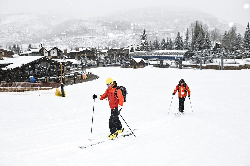 Skiers ski up an empty run at a Vail Resorts Inc. location in Vail, Colo., on March 19, 2020. MUST CREDIT: Bloomberg photo by Michael Ciaglo