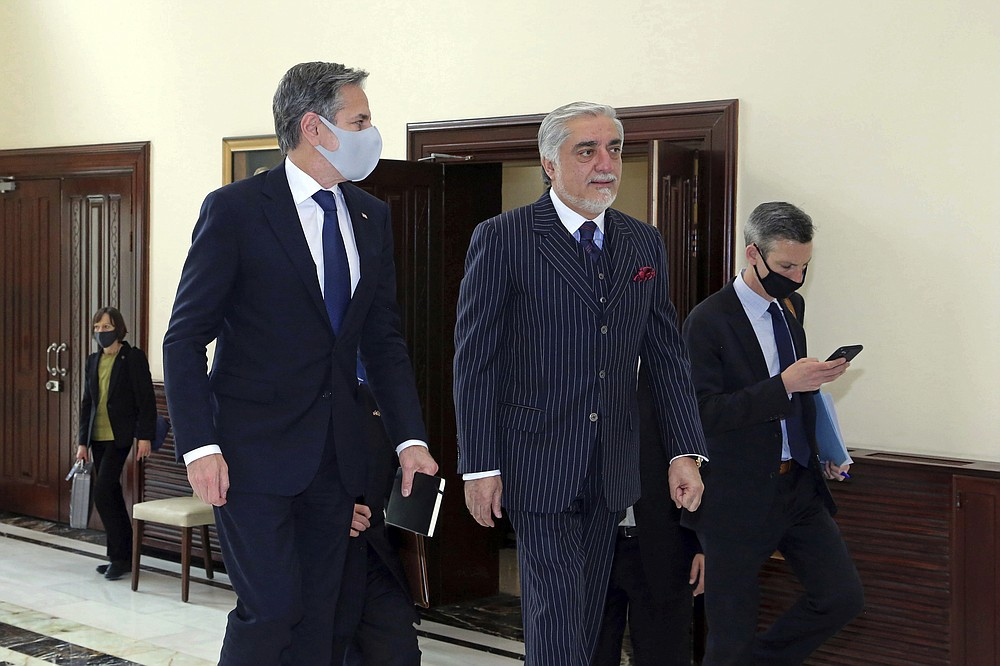 Abdullah Abdullah, Chairman of the High Council for National Reconciliation, center, walks with U.S. Secretary of State Antony Blinken, at the Sapidar Palace in Kabul, Afghanistan, Thursday, April 15, 2021. Blinken made an unannounced visit to Afghanistan on Thursday to sell Afghan leaders and a wary public on President Joe Biden's decision to withdraw all American troops from the country and end America's longest-running war. (Sapidar Palace via AP)