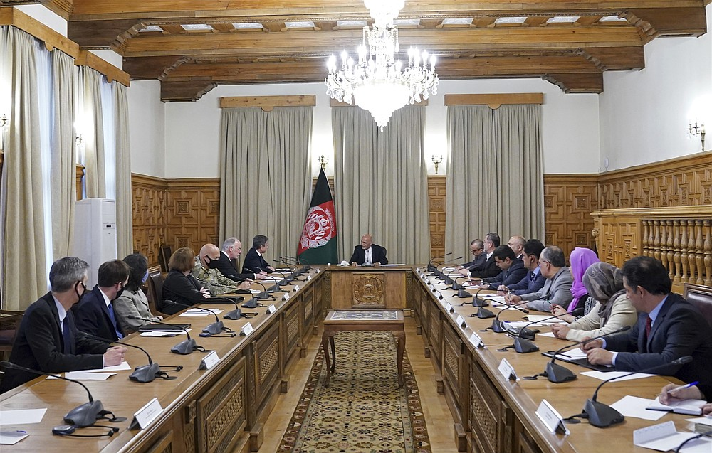 Afgan President Ashraf Ghani, center, meets with U.S. Secretary of State Antony Blinken, center left, and their delegations, at the presidential palace in Kabul, Afghanistan, Thursday, April 51, 2021. U.S. Secretary of State Antony Blinken made an unannounced visit to Afghanistan on Thursday to sell Afghan leaders and a wary public on President Joe Biden's decision to withdraw all American troops from the country and end America's longest-running war. (Afghan Presidential Palace via AP)