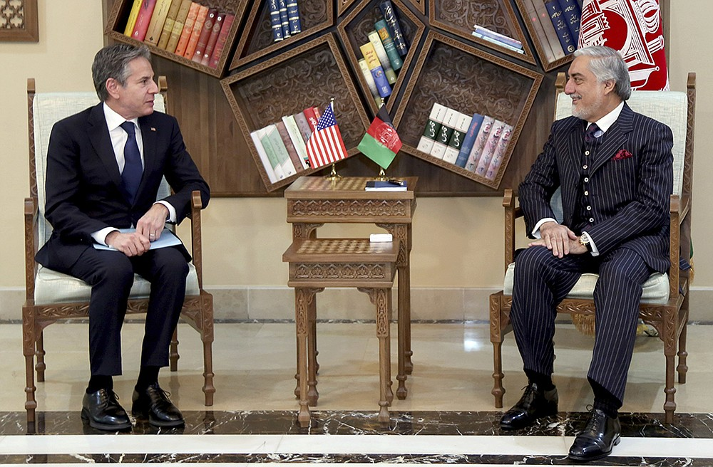"""U.S. Secretary of State Antony Blinken (left) meets Thursday in Kabul with Abdullah Abdullah, head of Afghanistan's National Reconciliation Council, during an unannounced trip to offer assurances about U.S. commitments despite plans to end the U.S. military presence there. Blinken told officials that """"we have a new chapter, but it is a new chapter that we're writing together"""" and stressed that America will continue financial support. More photos at arkansasonline.com/416blinken/. (AP/Sapidar Palace)"""