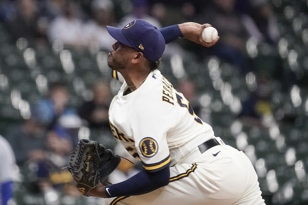 Milwaukee Brewers starting pitcher Freddy Peralta throws during the first inning of a baseball game against the Chicago Cubs Monday, April 12, 2021, in Milwaukee. (AP Photo/Morry Gash)
