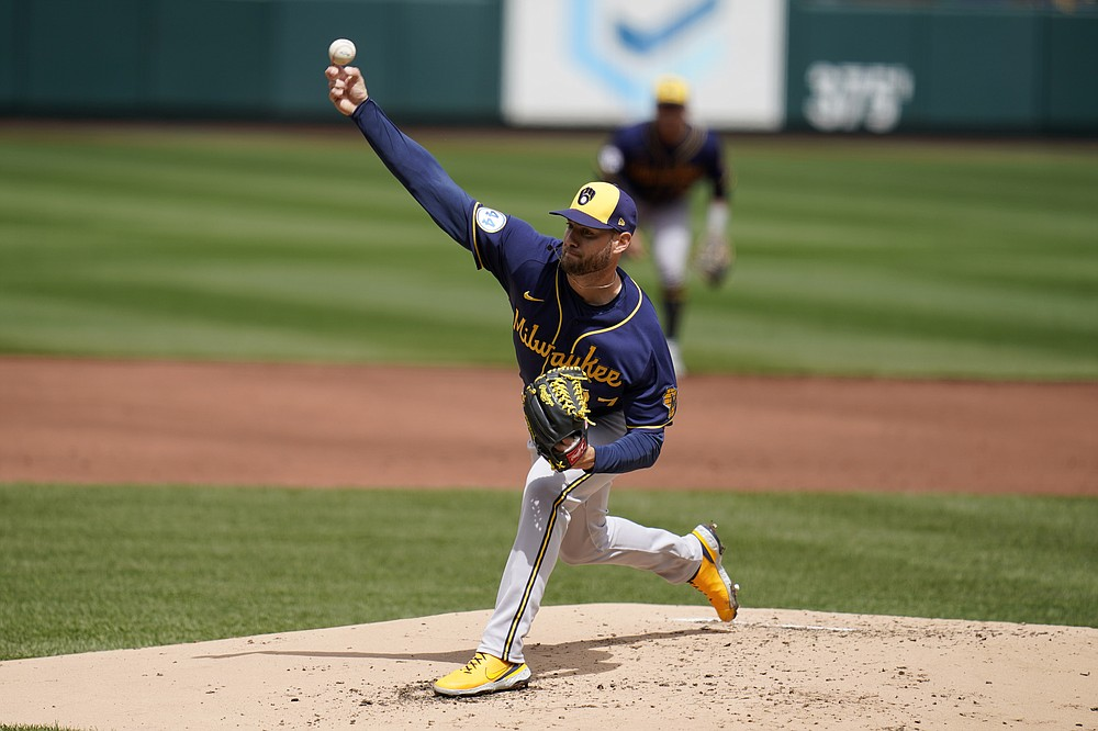 Milwaukee Brewers starting pitcher Adrian Houser throws during the first inning of a baseball game against the St. Louis Cardinals Saturday, April 10, 2021, in St. Louis. (AP Photo/Jeff Roberson)