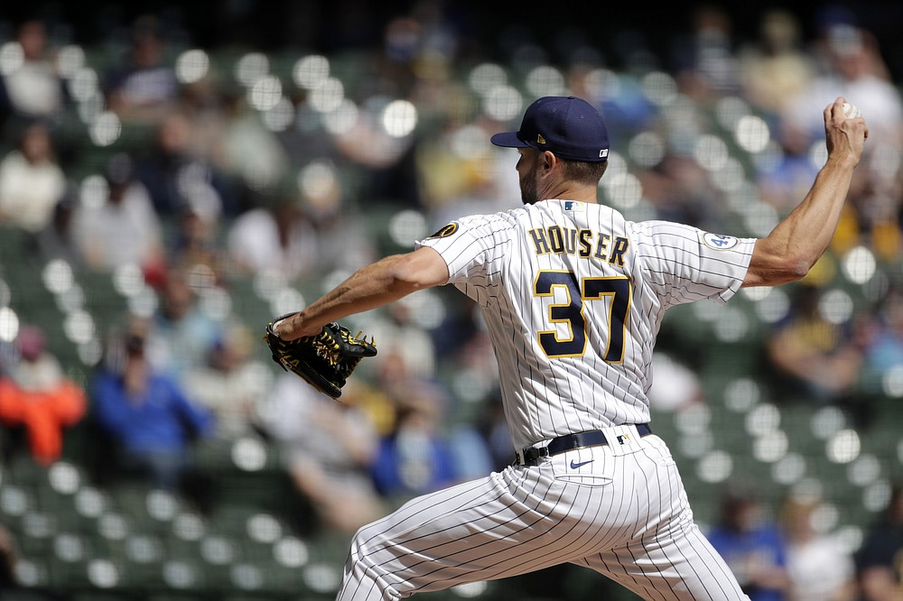 Milwaukee Brewers' Adrian Houser pitches during the first inning of a baseball game against the Minnesota Twins Sunday, April 4, 2021, in Milwaukee. (AP Photo/Aaron Gash)