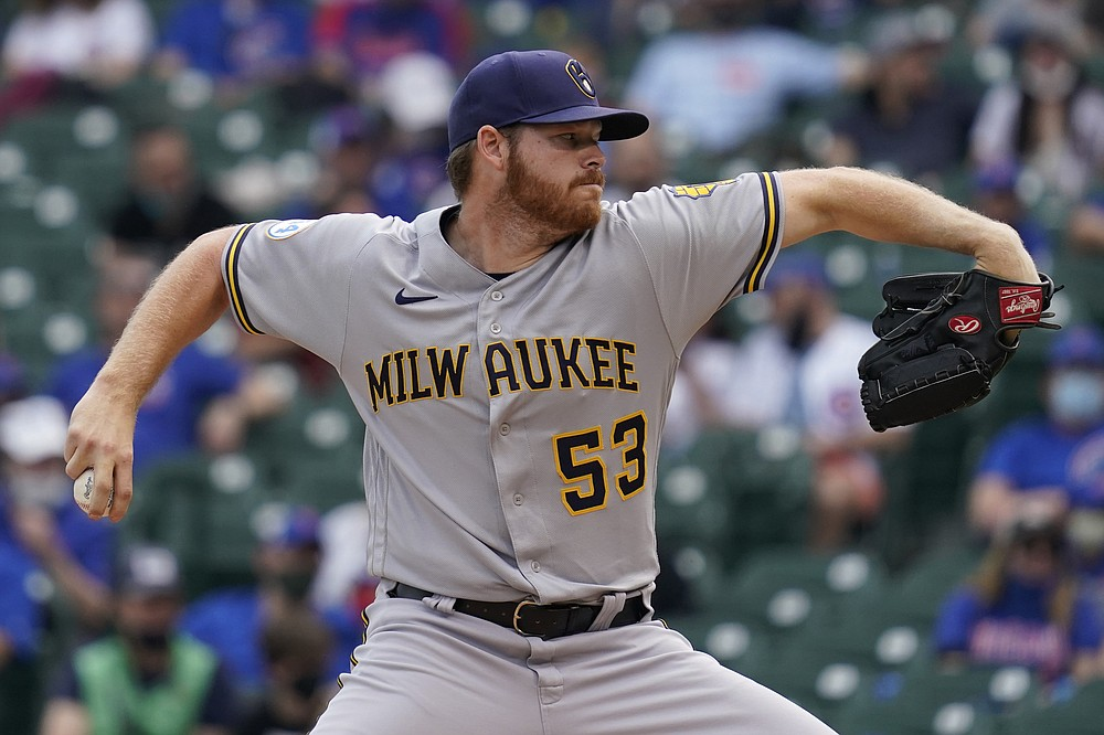 Milwaukee Brewers starting pitcher Brandon Woodruff (53) throws against the Chicago Cubs during the first inning of a baseball game in Chicago, Wednesday, April 7, 2021. (AP Photo/Nam Y. Huh)