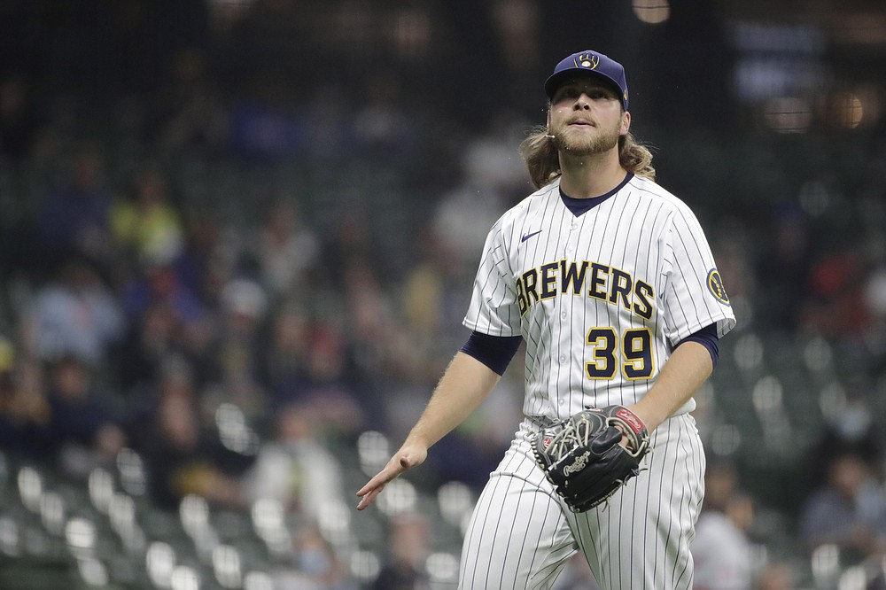 Milwaukee Brewers' Corbin Burnes reacts after striking out a batter during the sixth inning of a baseball game against the Minnesota Twins, Saturday, April 3, 2021, in Milwaukee. (AP Photo/Aaron Gash)