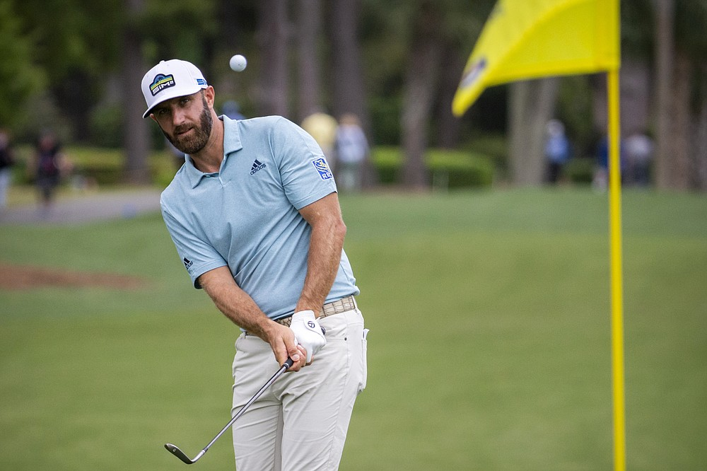 Dustin Johnson hits to the ninth green during the first round of the RBC Heritage golf tournament in Hilton Head Island, S.C., Thursday, April 15, 2021. (AP Photo/Stephen B. Morton)