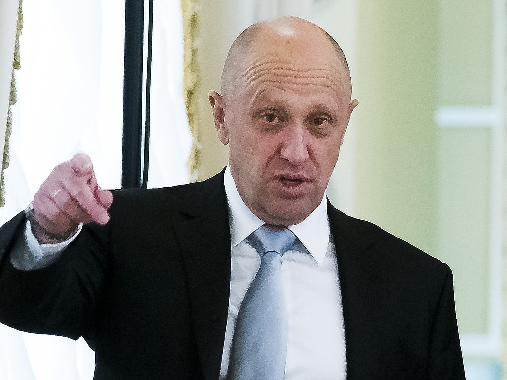 """FILE - In this Tuesday, Aug. 9, 2016, file photo, businessman Yevgeny Prigozhin, left, gestures on the sidelines of a summit meeting between Russian President Vladimir Putin and Turkish President Recep Tayyip Erdogan at the Konstantin palace outside St. Petersburg, Russia. Also on the list was the Kremlin's first deputy chief of staff, Alexei Gromov, several individuals linked to Yevgeny Prigozhin, a businessman with close ties to Russia's president, nicknamed """"Putin's chef"""" for serving Kremlin functions, and a number of front companies that U.S. Treasury says help Prigozhin evade sanctions imposed earlier. (AP Photo/Alexander Zemlianichenko, File)"""
