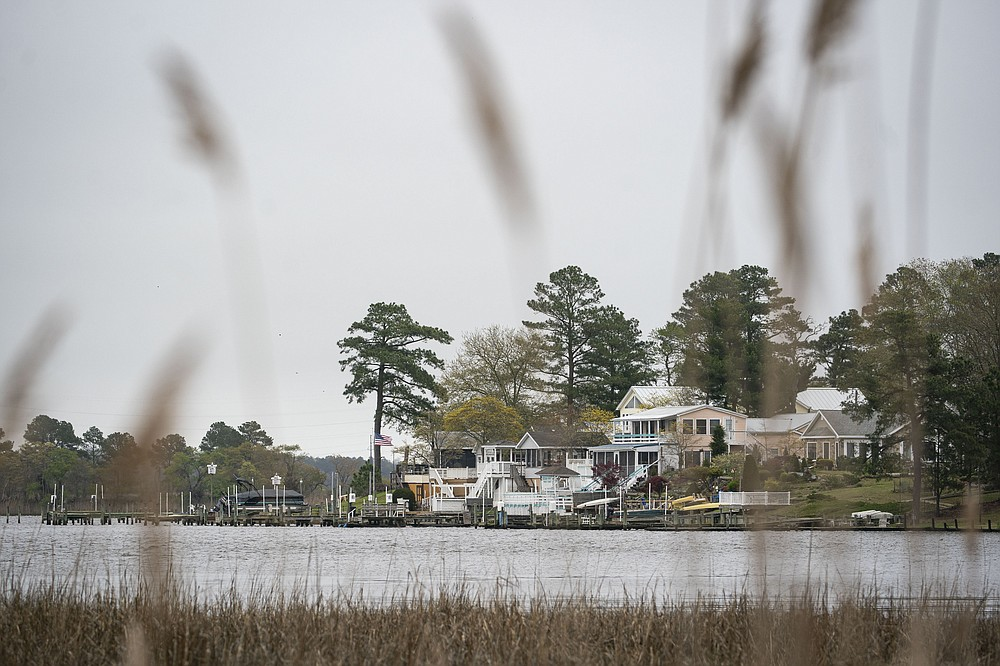 Houses sit along the bank of the Indian River, across the waterway from the Mountaire Farms plant in Delaware. MUST CREDIT: Photo for The Washington Post by Al Drago