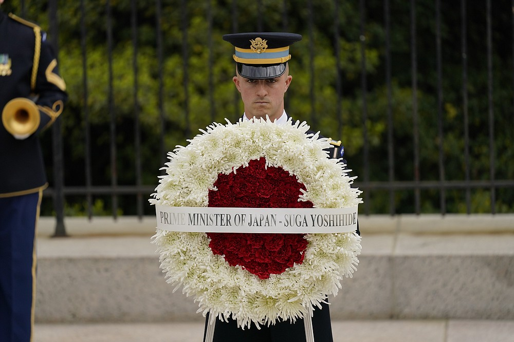 U.S. Honor Guard prepare for Japanese Prime Minister Yoshihide Suga at the Tomb of the Unknown Soldier where he will participate in a wreath laying ceremony at Arlington National Cemetery in Arlington, Va., Friday morning, April 16, 2021. President Joe Biden will be welcoming Japan's prime minister to the White House on Friday in his first face-to-face meeting with a foreign leader, a choice that reflects Biden's emphasis on strengthening alliances to deal with a more assertive China and other global challenges. (AP Photo/Carolyn Kaster)