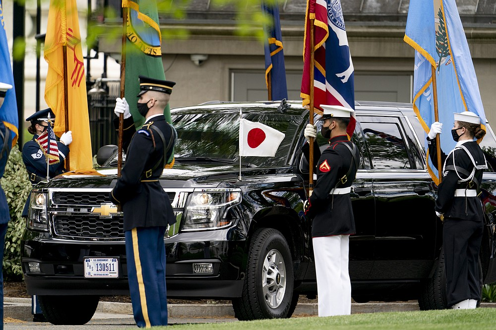 The car carrying Japanese Prime Minister Yoshihide Suga arrives at the West Wing of the White House in Washington, Friday, April 16, 2021. (AP Photo/Andrew Harnik)
