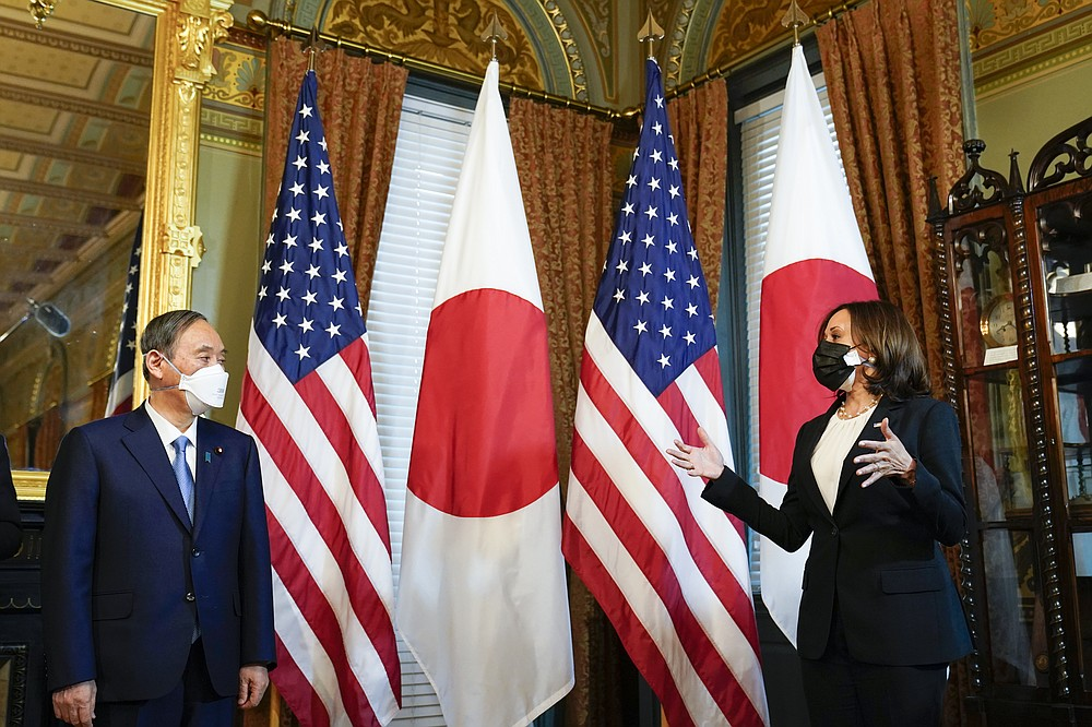 Vice President Kamala Harris meets with Japanese Prime Minister Yoshihide Suga in the ceremonial office in Eisenhower Executive Office Building in Washington Friday, April 16, 2021. (AP Photo/Susan Walsh)