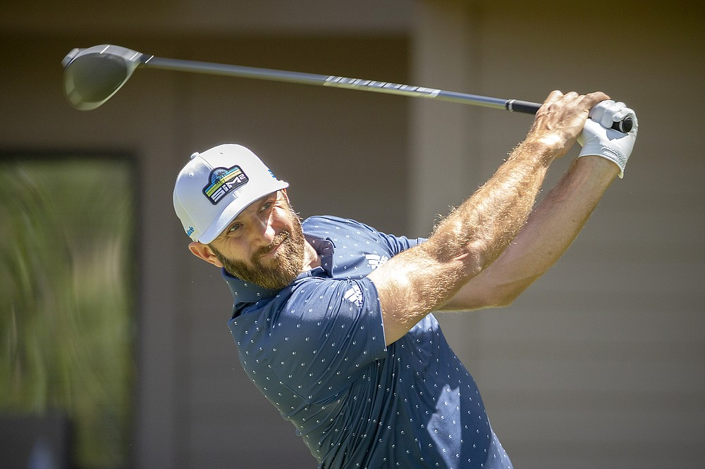 Dustin Johnson watches his drive off the third tee during the third round of the RBC Heritage golf tournament in Hilton Head Island, S.C., Saturday, April 17, 2021. (AP Photo/Stephen B. Morton)