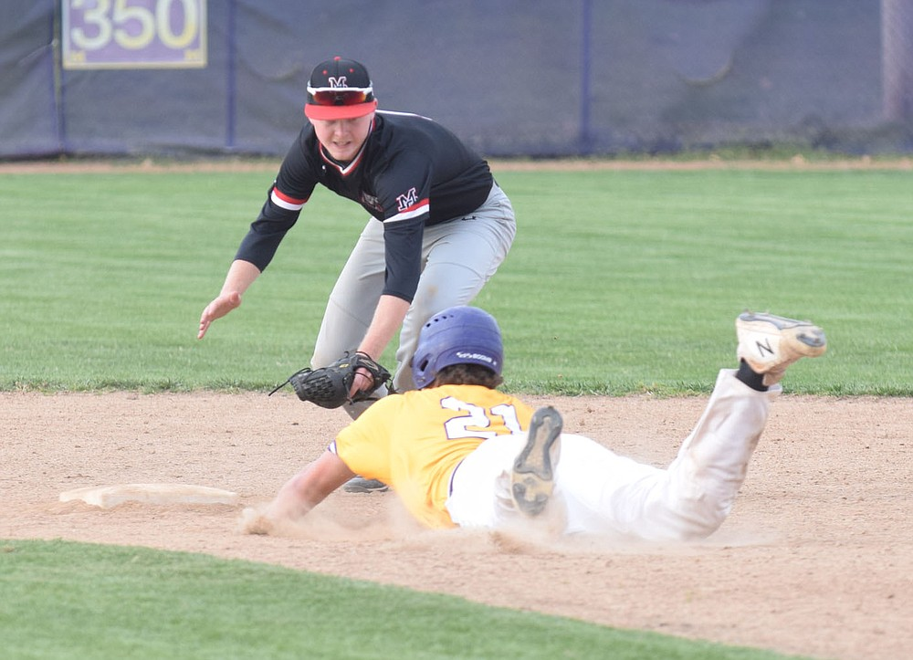 RICK PECK/SPECIAL TO MCDONALD COUNTY PRESS McDonald County second baseman Levi Helm is just a little late in attempting to tag Monett's Tanner Wright during the Mustangs 9-5 win on April 15 at Monett High School.