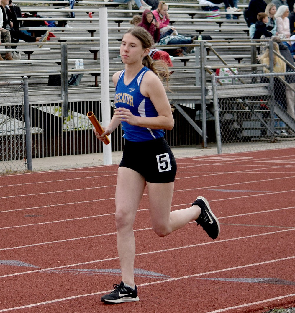 Westside Eagle Observer/MIKE ECKELS Heaven McGarrah starts her second lap of the girls 4x800 meter relay which was part of the 2A-1 District Track Meet on the track at Eureka Springs High School Friday afternoon. The Decatur team took first in this event.