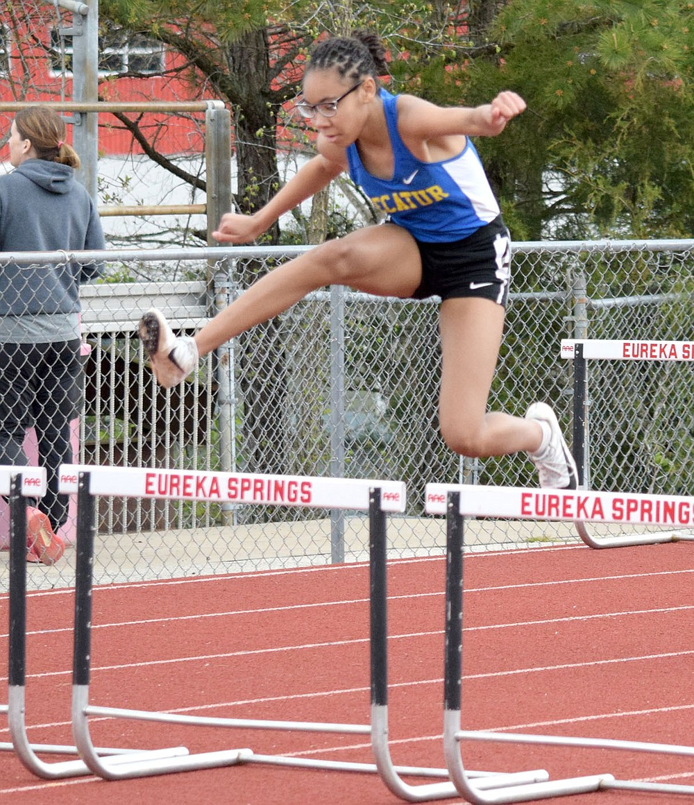 Westside Eagle Observer/MIKE ECKELS Pryia James leaps over the last hurdle on her was to a first place finish in the 100 meter hurdles for the Decatur junior high girls track team. The Decatur girls brought home a second place trophy from the 2A-1 District Meet in Eureka Springs Friday afternoon.