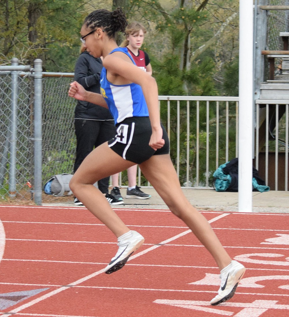 Westside Eagle Observer/MIKE ECKELS Decatur's Pryia James crosses the finish line for a first place finish in the girls 100 meter relay which was part of the 2A-1 Junior High District Meet in Eureka Springs Friday afternoon.