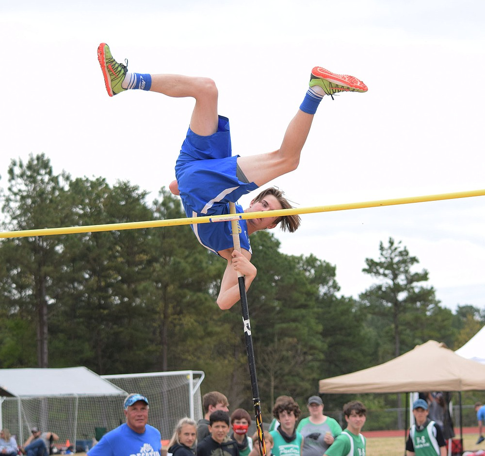 Westside Eagle Observer/MIKE ECKELS Dayton McGarrah clears the bar at nine feet for a first place finish in the pole vault event which was part of the 2021 2A-1 Junior High District Track Meet Friday afternoon in Eureka Springs.