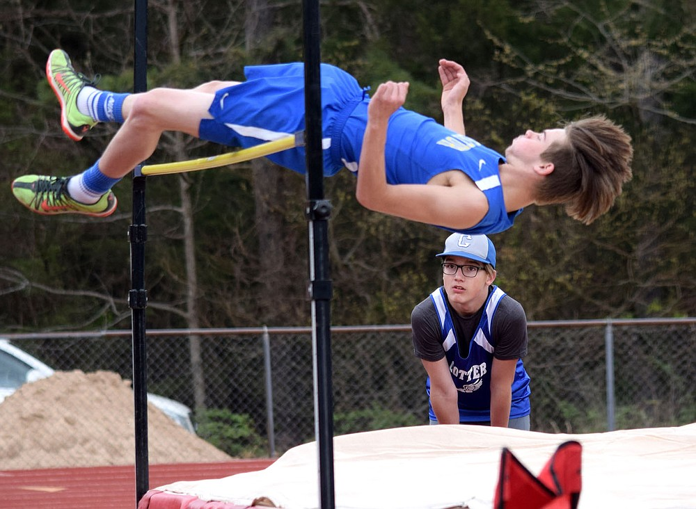 Westside Eagle Observer/MIKE ECKELS Dayton McGarrah easily clears the five foot six inch mark for a first place finish in the boys high jump during the 2A-1 junior high district track meet in Eureka Springs Friday afternoon, McGarrah, along with teammate Brian Ruiz, led the Decatur boys junior high track team to a second place finish in the district meet.