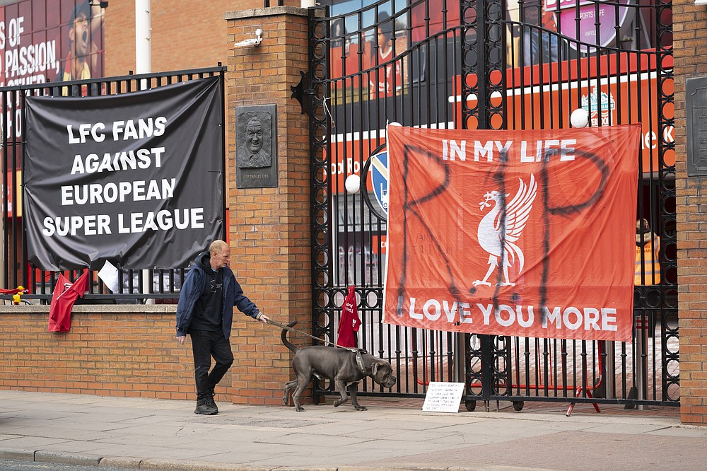 "Banners are seen outside Liverpool's Anfield Stadium after the collapse of English involvement in the proposed European Super League, Liverpool, England, Wednesday, April 21, 2021. Liverpool owner John W Henry has apologised to the club's supporters for the ""disruption"" caused by the proposed European Super League (ESL). (AP Photo/Jon Super)"