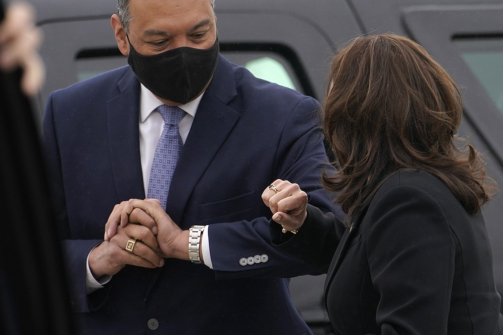 Vice President Kamala Harris exchanges and elbow bump greeting with Sen. Alex Padilla, D-Calif., on arrival in Oakland, Calif., Monday, April 5, 2021. (AP Photo/Jacquelyn Martin)