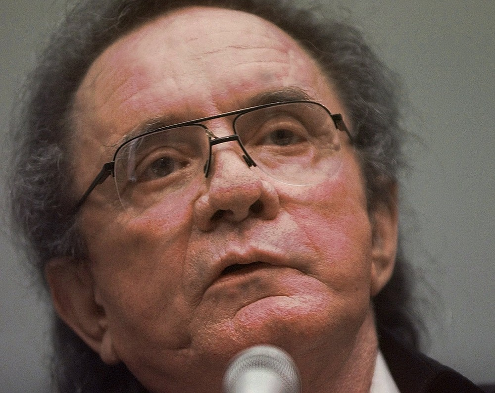 "FILE - In this Sept. 17, 1997, file photo, singer Johnny Cash testifies on Capitol Hill before the House Judiciary Committee hearing on copyright infringement in Washington. The Man in Black is about to get his own day in Arkansas. The Arkansas House on Tuesday, April 20, 2021, gave unanimous final approval to a bill that would make Feb. 26 ""Johnny Cash Day,"" sending it to Gov. Asa Hutchinson, who plans to sign it. (AP Photo/Ron Edmonds File)"