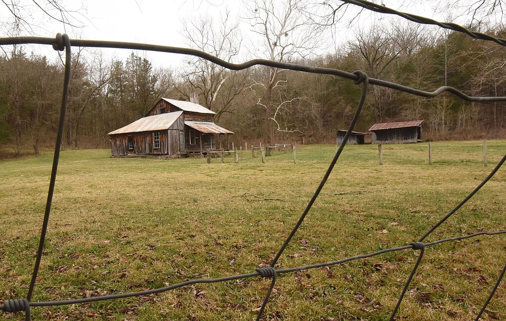 The home, barn and outbuildings of the Parker-Hickman farmstead, seen here on March 12 2021, can be explored by visitors to the Buffalo National River. The farmstead is north of Jasper, one-half mile west of Erbie campground. (NWA Democrat-Gazette/Flip Putthoff)