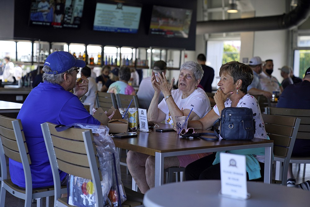 The Associated Press Baseball fans gather in the Bullpen Club at George M. Steinbrenner Field before a spring training exhibition baseball game between the New York Yankees and the Toronto Blue Jays in Tampa, Fla., on March 24.