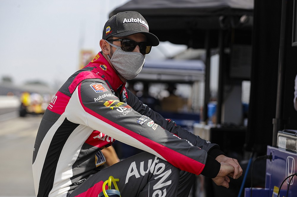"""FILE - Race driver Alexander Rossi waits for the start of practice for the IndyCar auto race at Indianapolis Motor Speedway in Indianapolis, in this Friday, July 3, 2020, file photo. Alexander Rossi doesn't mince words about last season, when Andretti Autosport won just one race as an organization. """"I just think we sucked globally,"""" he said of the effort. (AP Photo/Darron Cummings, File)"""